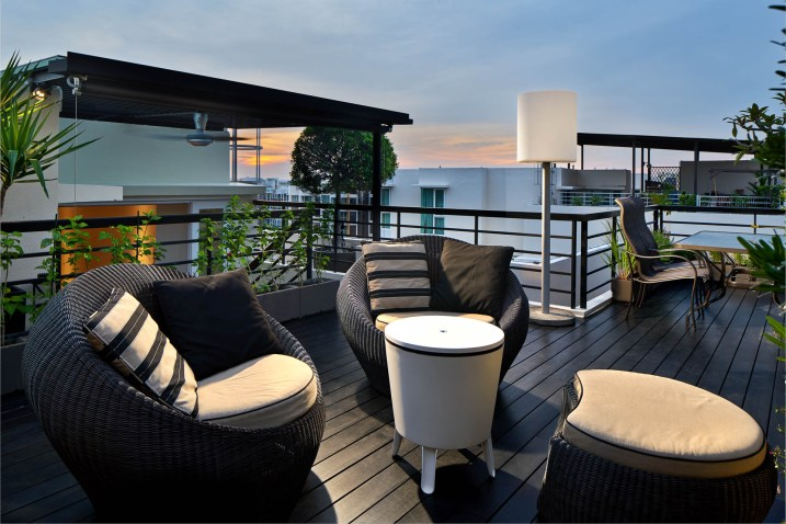 Interior design photography showing rooftop balcony with chairs at sunset at simei rise condo in singapore