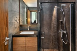 Interior design photography showing small bathroom with shower at simei rise condo in singapore
