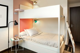 Interior design photography showing bunk bed and reading lamp in girls bedroom at simei rise condo in singapore