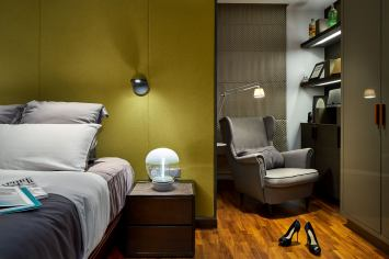Interior design photography showing bedroom with reading chair and bed at simei rise condo in singapore