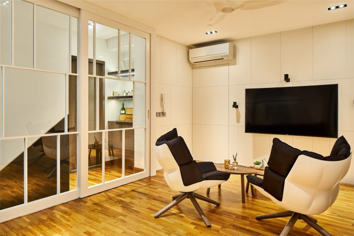 Interior design photography showing a living area with glass sliding door at simei rise condo in singapore