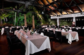 arbenz restaurant interior photography showing tables in a dining setup at night