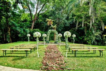 architectural photography of the outdoor wedding setup at swiss club in singapore with arch and walkway