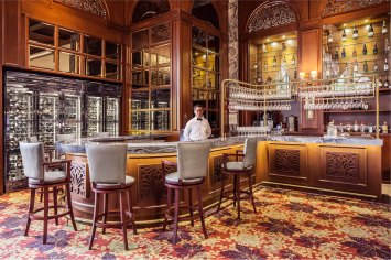 Interior photography of the churchill room main bar with staff at the tanglin club in singapore