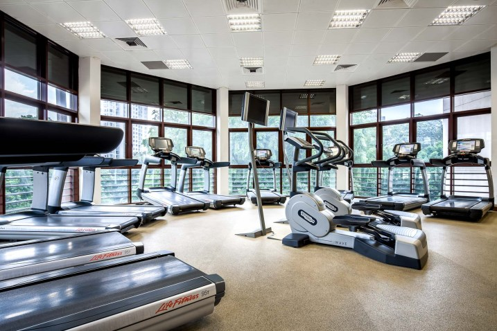 Interior photography at the gym showing treadmills at the tanglin club in singapore
