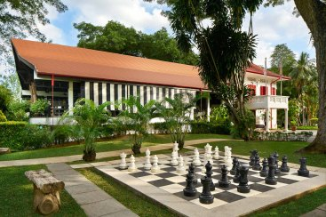 Architectural photography showing the outdoor chesboard at Swiss Club in Singapore Main Clubhouse with Outdoor Chess Set