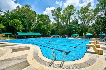 Interior Photography overview of pool at swiss club singapore