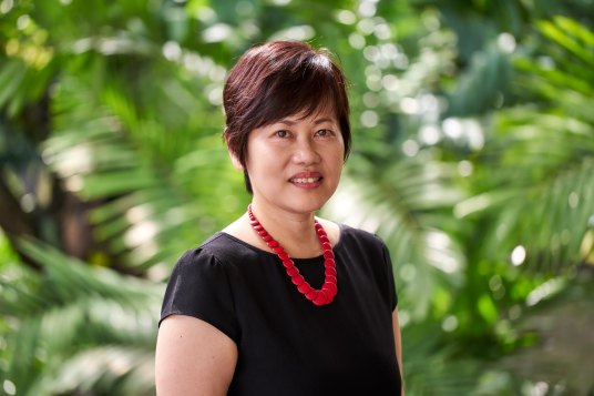 corporate portrait of female staff with brown hair at tanglin club in singapore