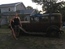 Our nephew and niece-in-law reviving one of Dad's old cars.