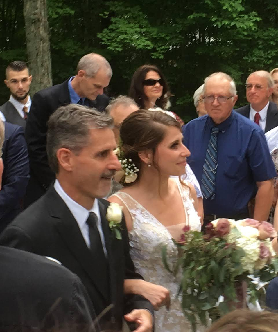 Tim and Ashley walk down the aisle