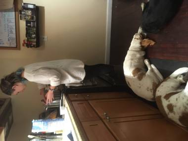 Mollie cooks with the dogs at her feet.