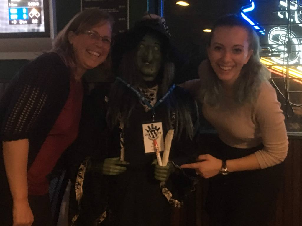 Mollie and Chrissie with a pretend witch holding swag.
