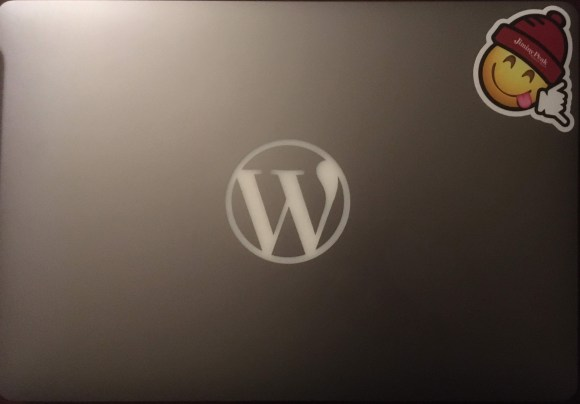 MacBook Pro with WordPress logo and only one sticker.
