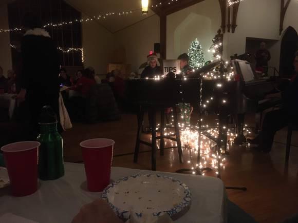 Kids in Santa hats singing