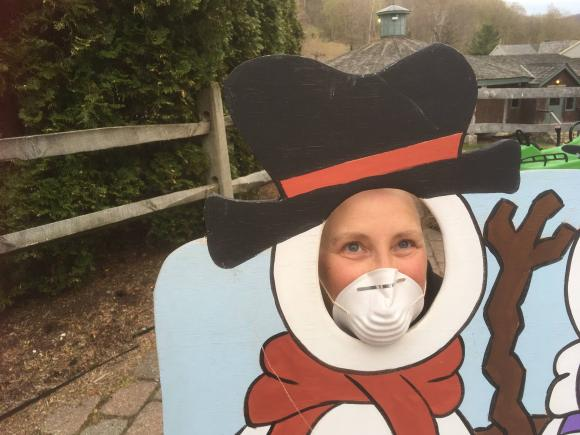 Chrissie posing in a snowman face with a facemask on due to Covid-19.