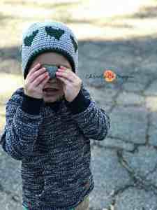 heart hat, boy's heart hat, green hearts with gray hat, holding heart rock