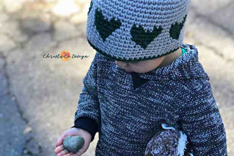 heart hat, boy's heart hat, green hearts with gray hat, holding heart rock