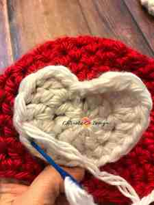 baby hat, sizes newborn to 12 months, red hat white heart, how to sew on applique