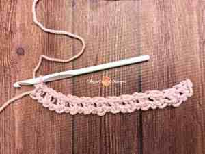 pink yarn swatch white hook