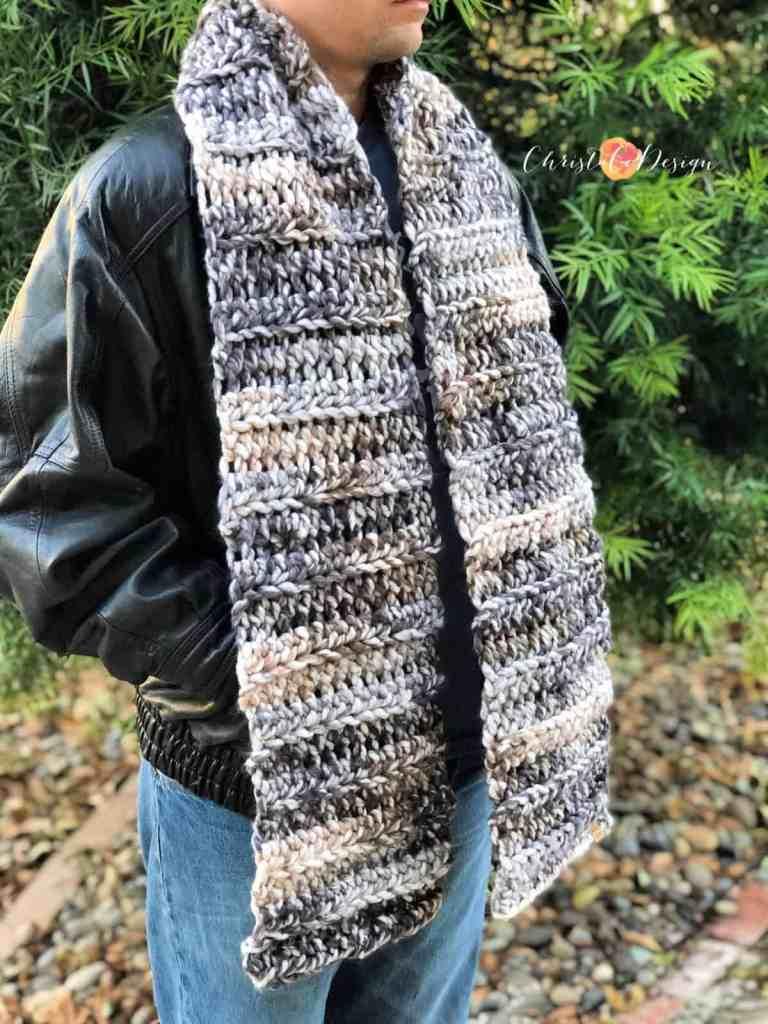 Man's super scarf crochet pattern in grey Lion Brand Color Clouds jumbo yarn.