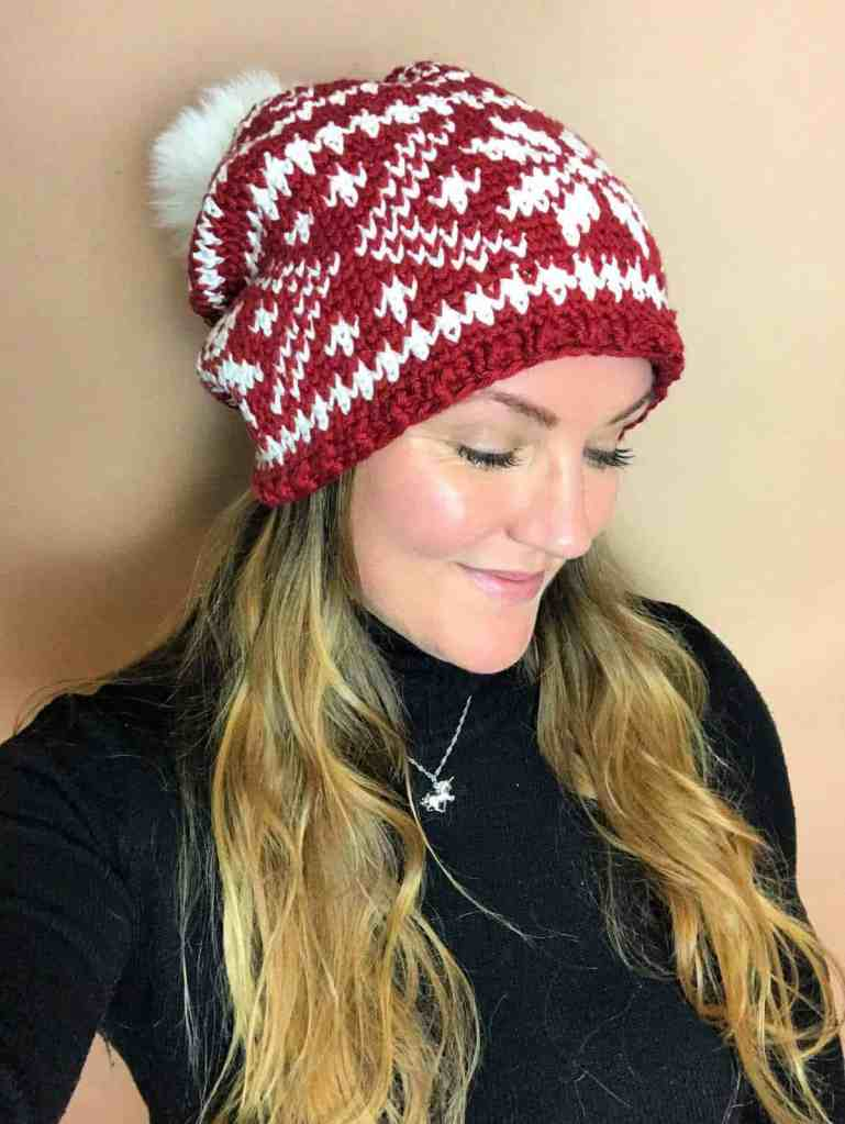 picture of woman in crochet snowflake hat