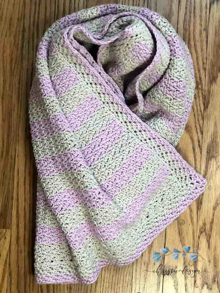 picture of striped pink and grey blanket twisted flat