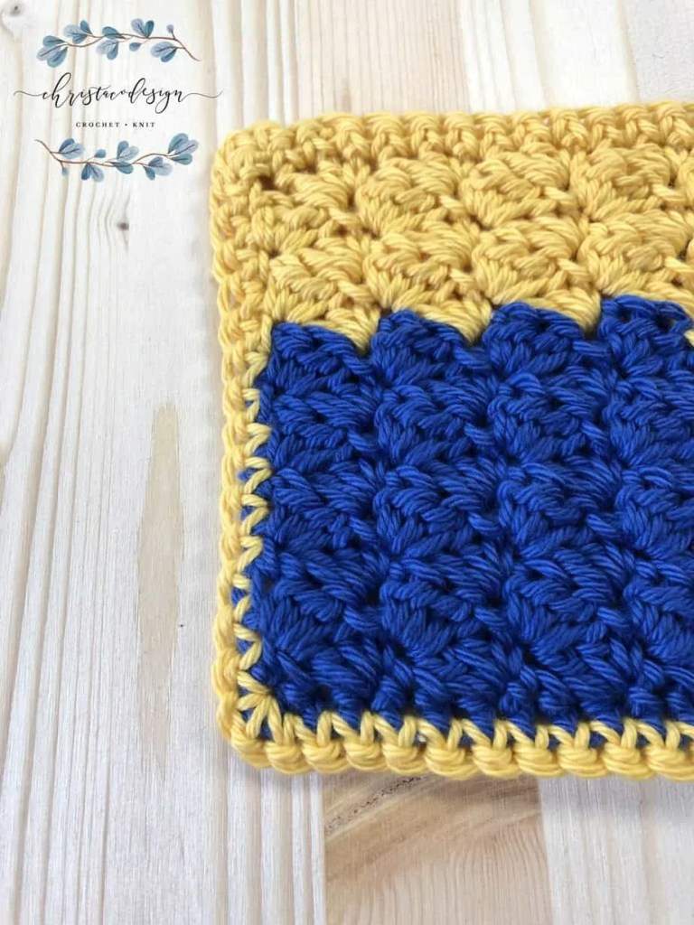 picture of crochet washcloth pattern in yellow and blue