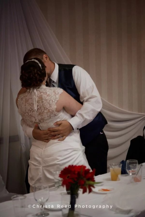 a romantic kiss at the wedding reception