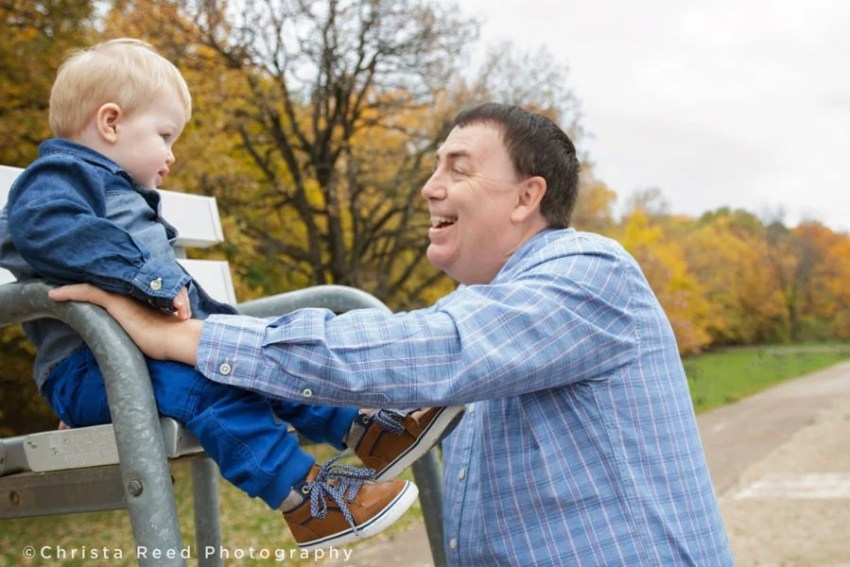 father and son fall portrait at lake ann park chanhassen