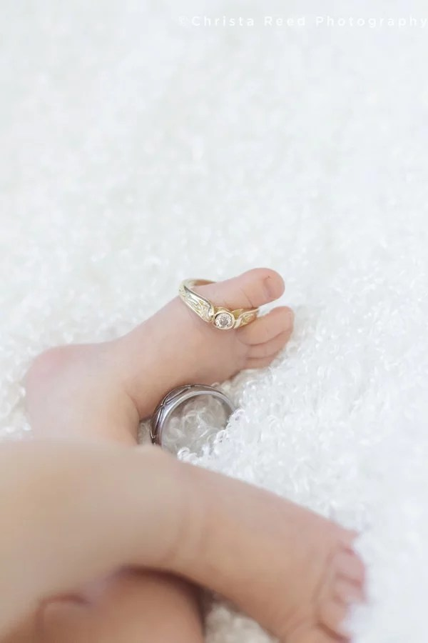 wedding rings on baby's feet for newborn portrait session
