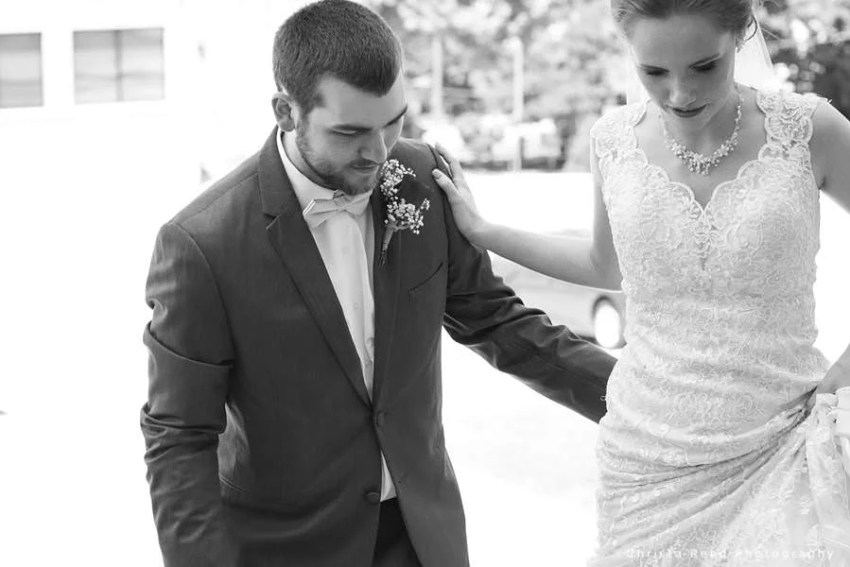 candid black and white photograph of bride and groom in mankato