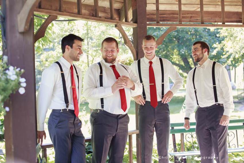 groomsmen in mankato have red ties and grey pants for fourth of july wedding