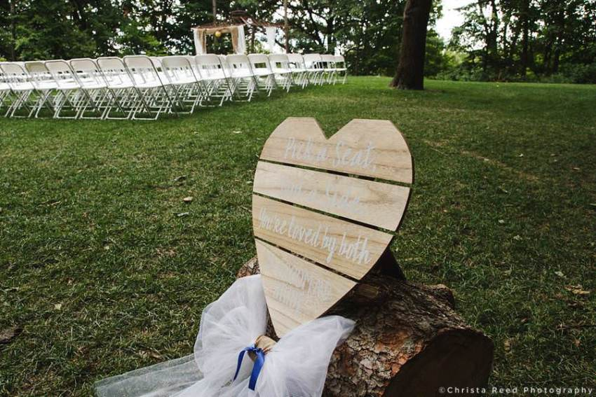 heart shaped wooden wedding sign with calligraphy
