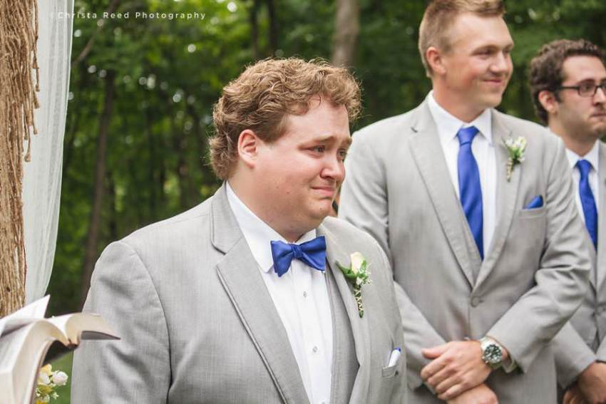 groom crying when he sees bride
