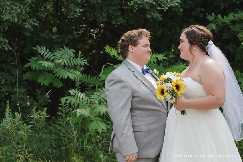 bride and groom smile after ceremony