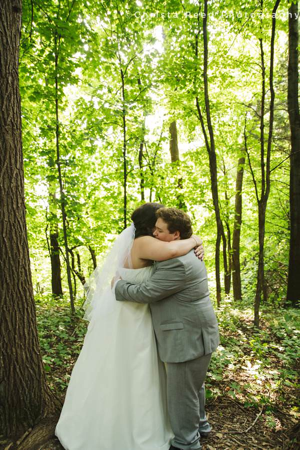 wedding couple hugs in the forest