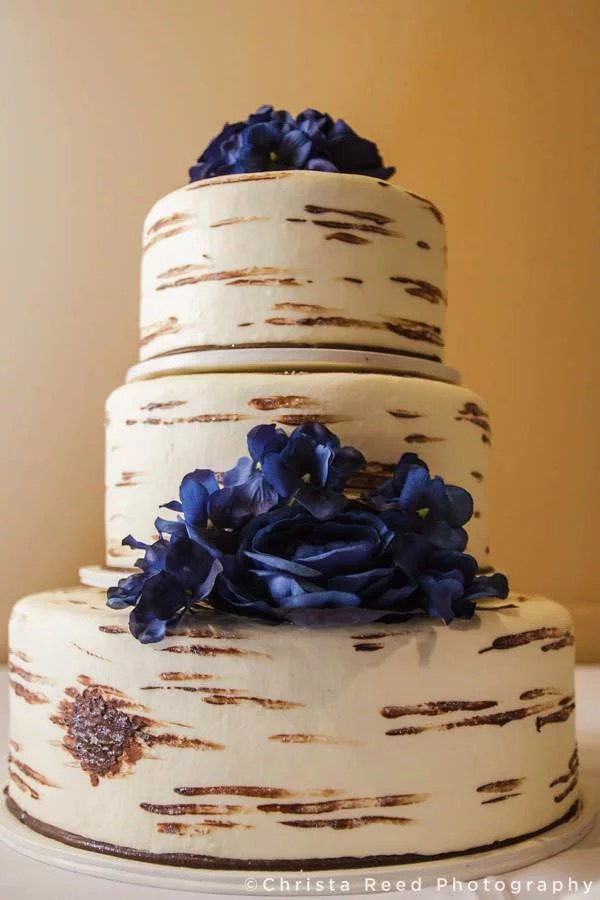 birtch bark cake with blue flowers by buttercream creations