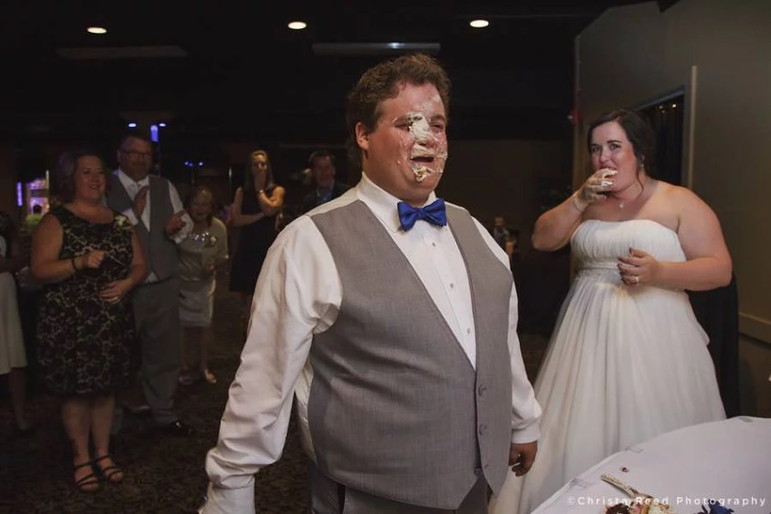 groom has cake on his face after food fight