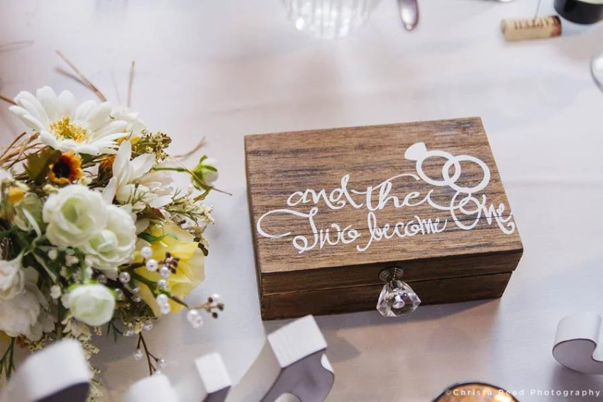 oak ring box on table at wedding reception