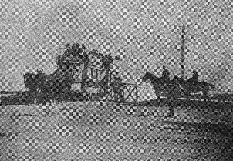 A double-decker horse tram crossing the original Seaview Road bridge on the way to Christchurch [ca. 1900]