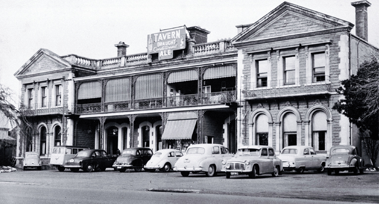 Cars parked outside the Grenadier Hotel in Oxford Terrace [ca. 1960]