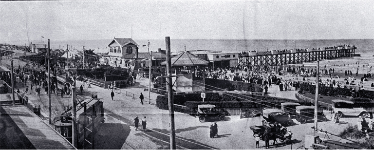 General view of pier and enclosures : showing terminus of two trams and pier front. [ca. 1920] CCL PhotoCD 18, IMG0020