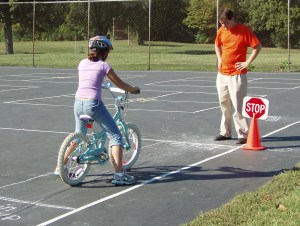 Child learning safety rules of biking