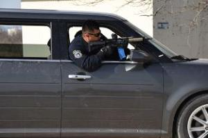 17th Security Forces Squadron Police Officer, John Hernandez, practices approaching the scene of an active shooter during the tactical driving course at the shoot house on Goodfellow Air Force Base, Texas, Feb. 27, 2019. Individuals practiced engaging targets while operating a vehicle and navigating through multiple advanced driving courses. (U.S. Air Force photo by Senior Airman Seraiah Hines/Released)