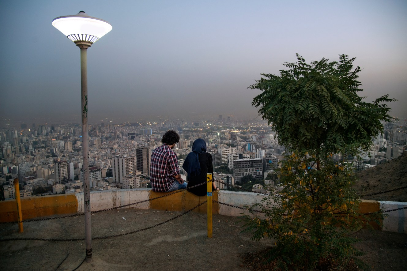 A young couple enjoying the city view from Darband, a popular spot for tehranis in search of a little peace.