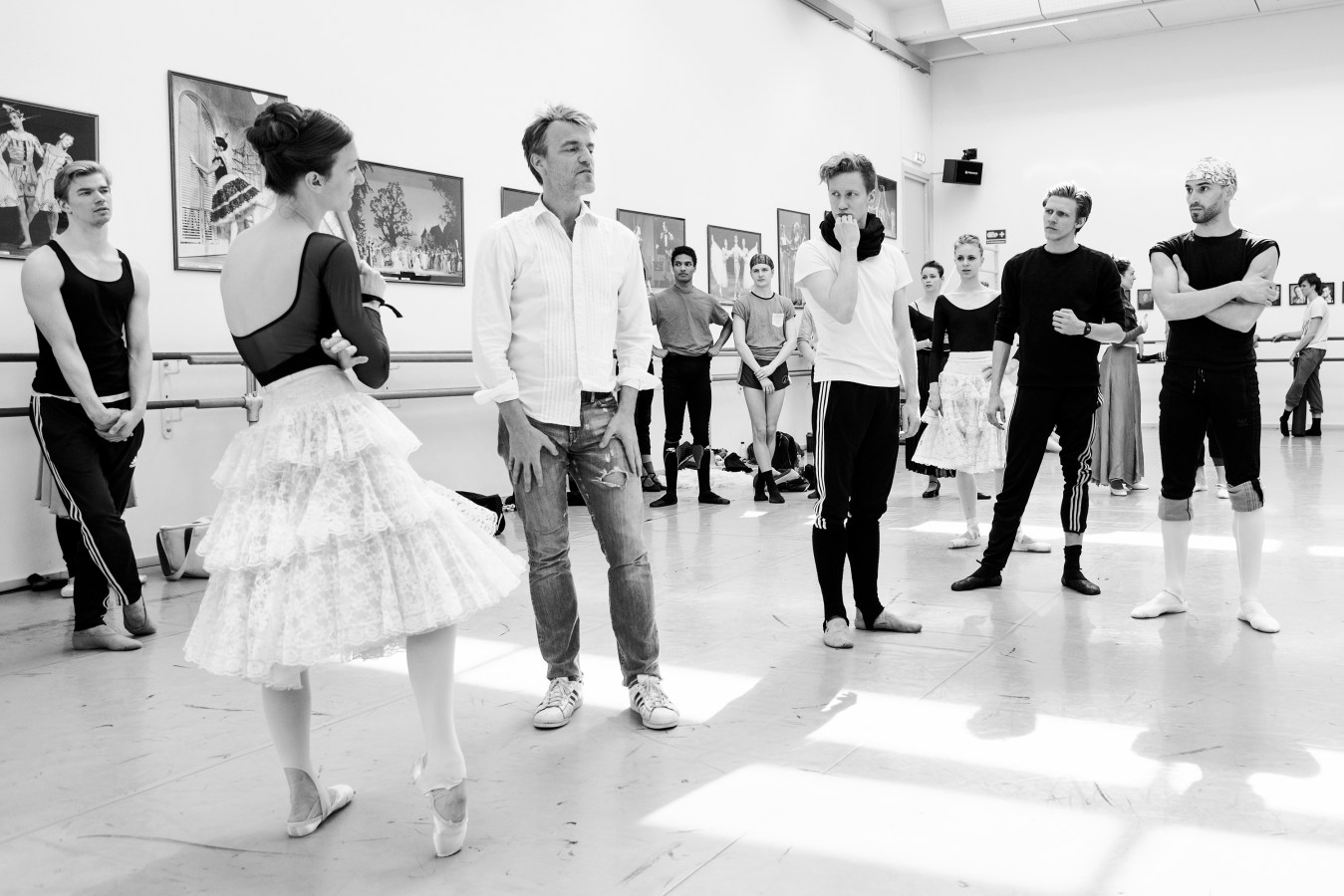 Artistic leader Nikolaj Hübbe (center with jeans) instructs dancers Gregory Dean, J'aime Crandall, Jón Axel Fransson, Ida Praetorius, Marcin Kupinski and Jonathan Chmelensky in an early rehearsal of Don Quixote, 2016. In Hübbe's era, the ballet has gone from being an elitist and closed world, to become a dance that many Danes have taken into.