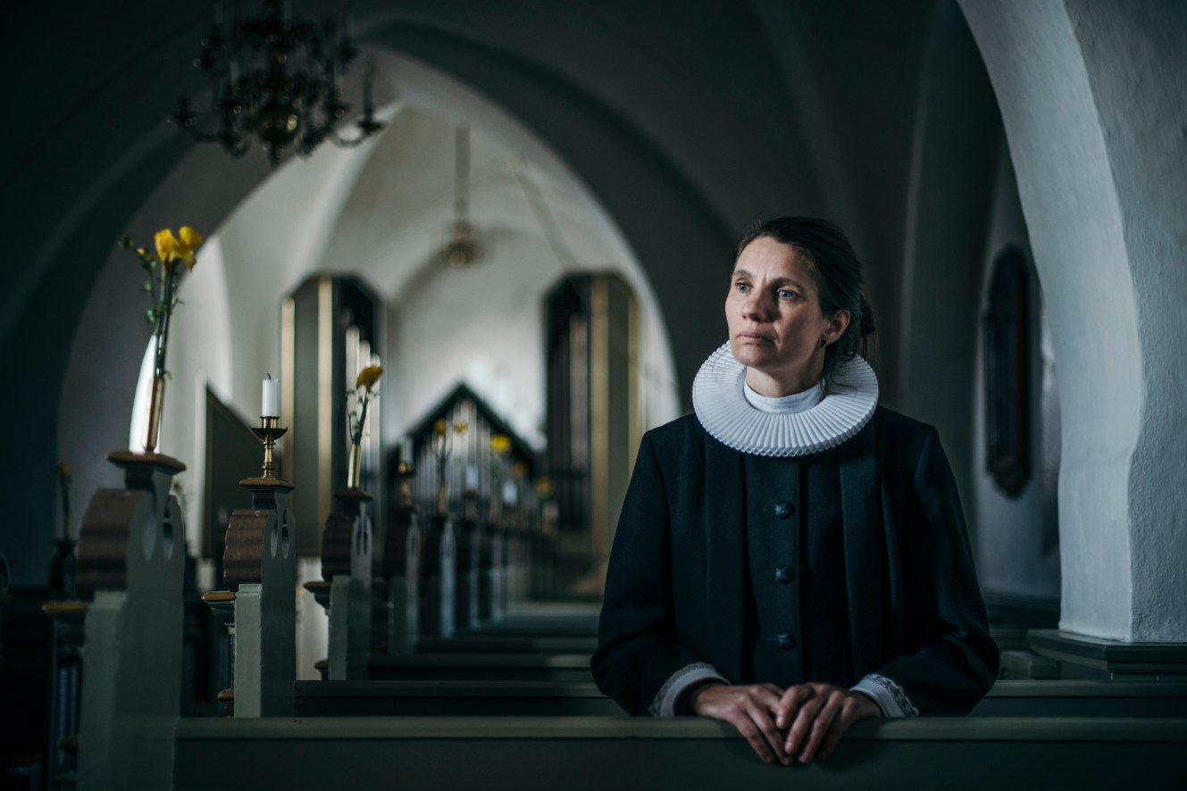 "We experienced how we all are deeply depending on each other. Malene Guassora, 43, a priest. A dark winter evening after a protestant confirmation event in Gadstrup Church, the priest Malene along with her guests finds a lifeless man in the cemetery toilet. Malene heads for an AED at the city sports center, while the guests are trying to resuscitate the man. ""I drove up to Ramsø Sports Center in cassock and all. The AED guided us through each step, and although we were told that we did everything we could, the man died. It was a shocking experience. Right there in the cemetery death came very close. But at the same time it was also touching to see how people responded. An amazing sense of community grew from a difficult and emotional situation. I talked a lot with the confirmands about it afterwards and I used it in my sermons. There is an incentive to help each other in Christianity, and that was what we did that night. I think it was instructive for young people to see that although we live in a selfish world we are also deeply interdependent. As a priest I often meet death but not in this sudden manner. Life is a gift but also very fragile. We have now prepared ourselves. We've got an AED at the church, and the parish council has been on a first aid course."""