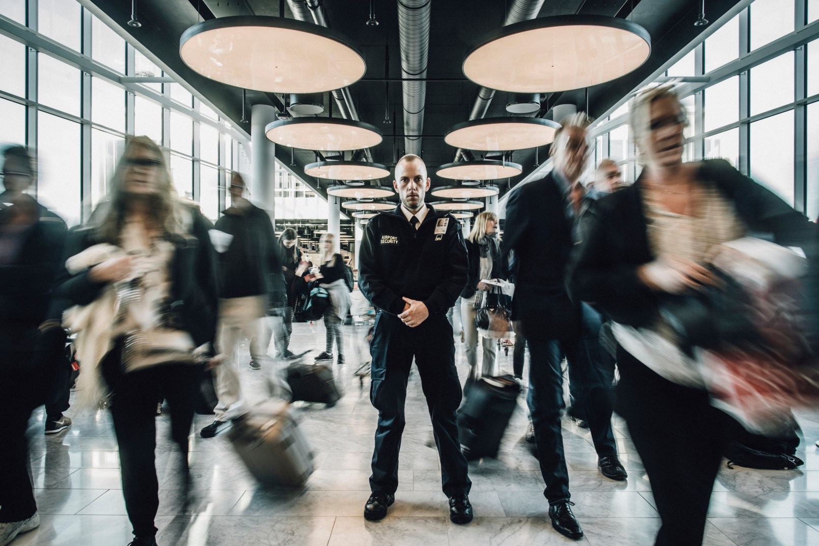"""I always call my father when I have brought someone back to life. Thomas Pærregaard, 31, a security guard at Copenhagen Airport. On one of his guard rounds in the airport terminal he suddenly hears a strange 'plump!' sound. Behind him, an older man has fallen to the ground. Thomas instinctively runs towards the man, at the same time alarming the airport rescue team and pulling down the AED from the wall. """"As a security guard I am trained to provide first aid. I knew immediately that the man had a sudden cardiac arrest. You can often see by the way the mouth opens and closes, after which the tongue moves back and forth. I laid him on his back, secured him free airways, tore open his shirt, switched the AED on and attached the pads on his chest. Three of my colleagues came in the same second. The AED guided us. It starts immediately to give you a series of visual and verbal prompts informing you of what you need to do. You can't jolt too much or wrong. It is important to remember. In that way the AED is a great help in a difficult situation. A colleague checked the man's wallet. People feel more secure when they wake up after a sudden cardiac arrest if they are addressed by their name. His name was Per and he was 60 years old. Later when I drove home, I called my father. I always do when I have brought someone back to life. I don't expect any thanks. But I am proud when I have made a difference."""""""