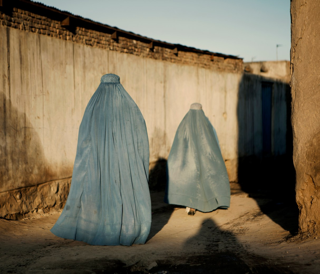 Two women wearing blue burqas walk through an alleyway after leaving a market in Lashkar Gah. In June 2011, President Obama announced his plan to begin the withdrawal of US troops from Afghanistan, but there is currently no end date for the war in the troubled country. Helmand is the largest province in Afghanistan, and the heart of the war against terror. Commanders on the ground have described the situation as the most brutal conflict the British Army has been involved in since the Korean War. Much of the fighting between NATO and Taliban forces is taking place in this province and Helmand is a true Taliban stronghold. The Helmand River flows through the mainly desert region. With these images I am trying to show a softer side to this troubled area of Afghanistan.