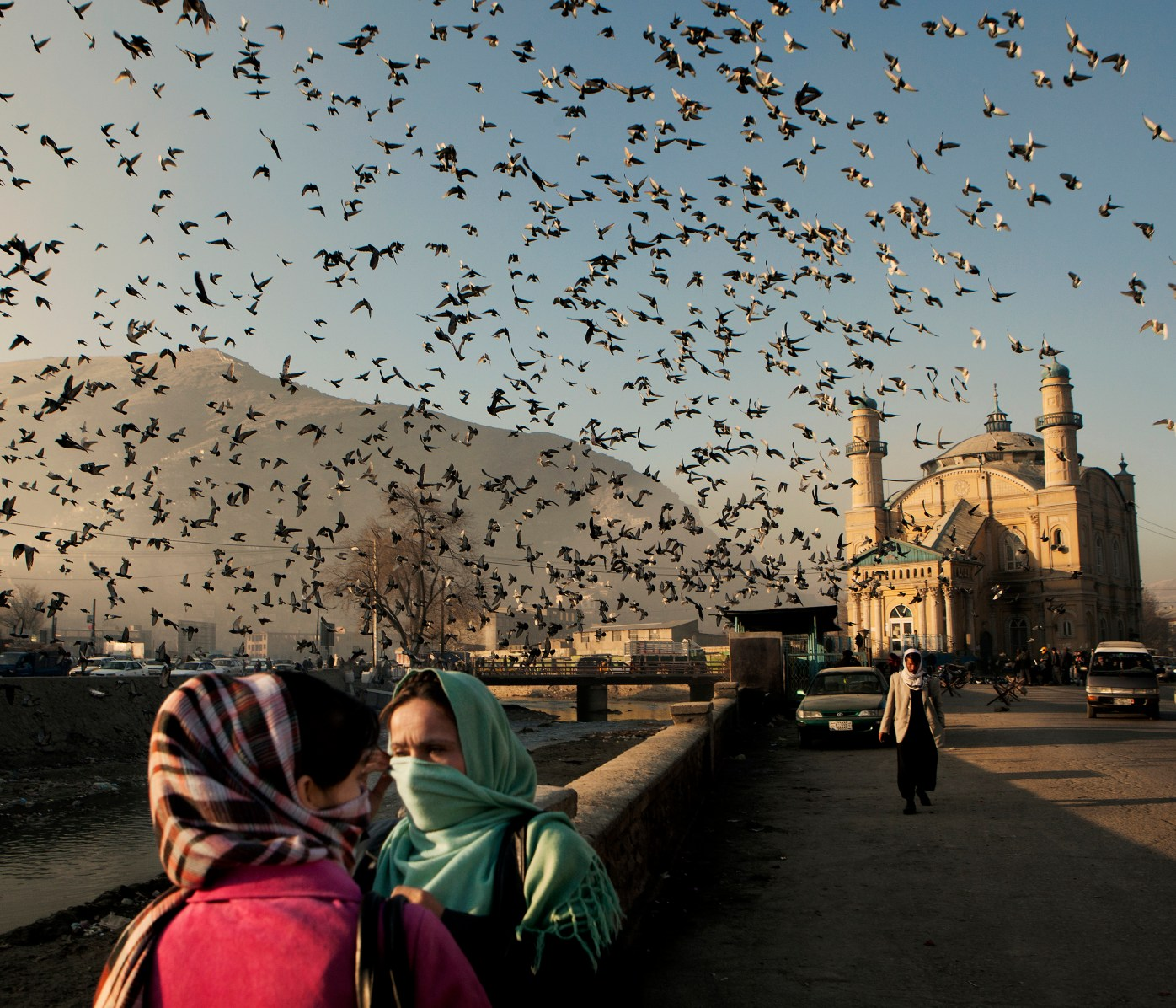 A huge flock of pigeons fly into the air behind two women standing by the Kabul River. In the background is the Shah Dashamshara Mosque. In June 2011, President Obama announced his plan to begin the withdrawal of US troops from Afghanistan, but there is currently no end date for the war in the troubled country. Helmand is the largest province in Afghanistan, and the heart of the war against terror. Commanders on the ground have described the situation as the most brutal conflict the British Army has been involved in since the Korean War. Much of the fighting between NATO and Taliban forces is taking place in this province and Helmand is a true Taliban stronghold. The Helmand River flows through the mainly desert region. With these images I am trying to show a softer side to this troubled area of Afghanistan.